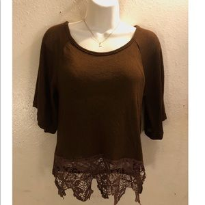 Brown blouse with crochet trimming